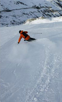 Skier carving turns in Austria