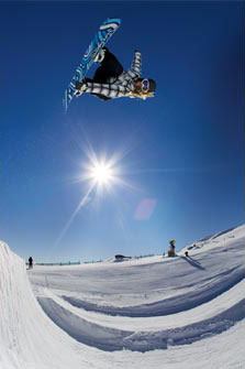 Snowboarder in the half-pipe